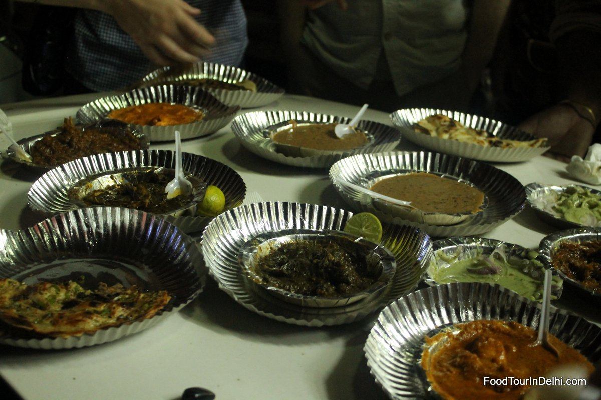 Dinner of Daal, Butter Chicken, Mutton, Naan, Parantha and other breads