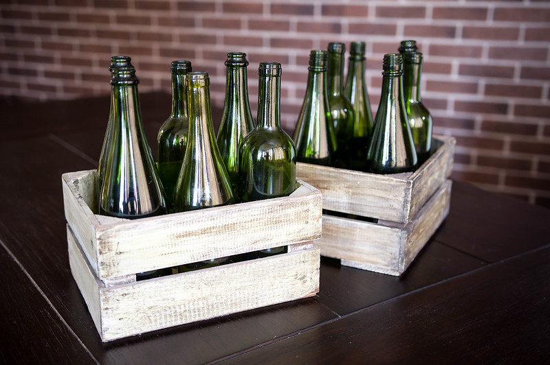 Two boxes of green wine bottles