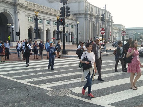 Pedestrians in the crosswalk outside Union Station