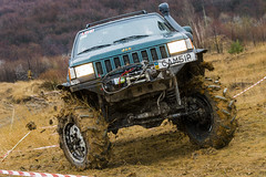 Off-road vehicle brand Jeep Cherokee overcomes a track