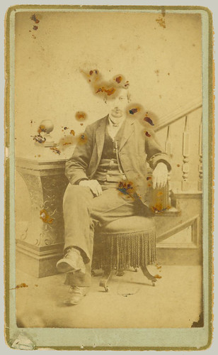 CDV seated man