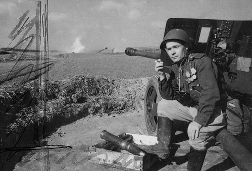 Soviet LCpl  sitting on  his  76.2-mm Antitank gun ZiS-3  1942.