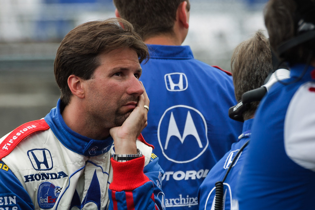 Michael Andretti dejectedly watches timing and scoring during Friday practice at the 2001 CART race in Portland