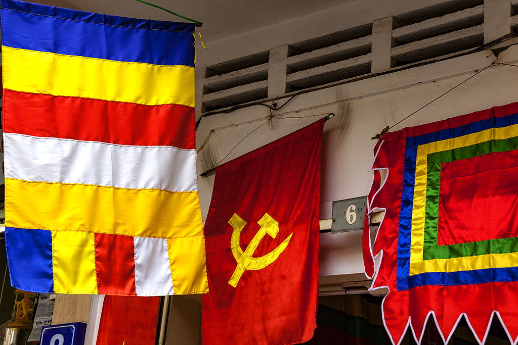 Buddhist and Communist flags--Hanoi