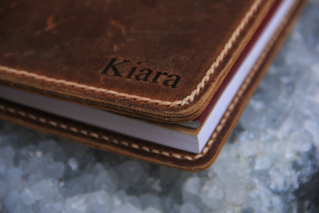Close up of the contrast stitching on the JooJoobs leather travel wallet