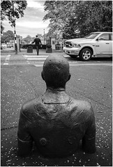 Antony Gormley statue roadside at Scottish National Gallery of Modern Art