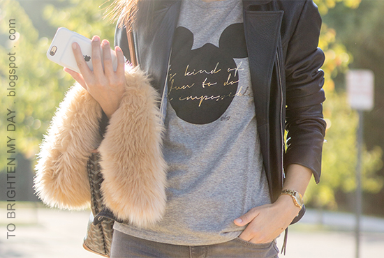 faux fur scarf, black leather jacket, gray graphic tee, gold watch, gray skinny jeans