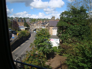 A street in Matlock, viewed from a train window while passing over a bridge above the street.