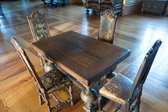 Antique table and leather-backed chairs