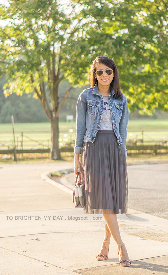 denim jacket, gray graphic tee, dark gray tulle midi skirt, colorblocked tote, suede sandals with jewels and ankle ties