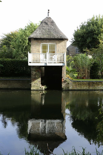 Thatched boathouse on River Great Ouse, Godmanchester, Cambridgeshire