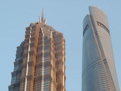 An odd couple - Shanghai modern skyline tops - China