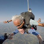 Rockin It Out With Tandem Skydiver Emily and Her Instructor Cliff Alfiche Photo By Jeff McCarty