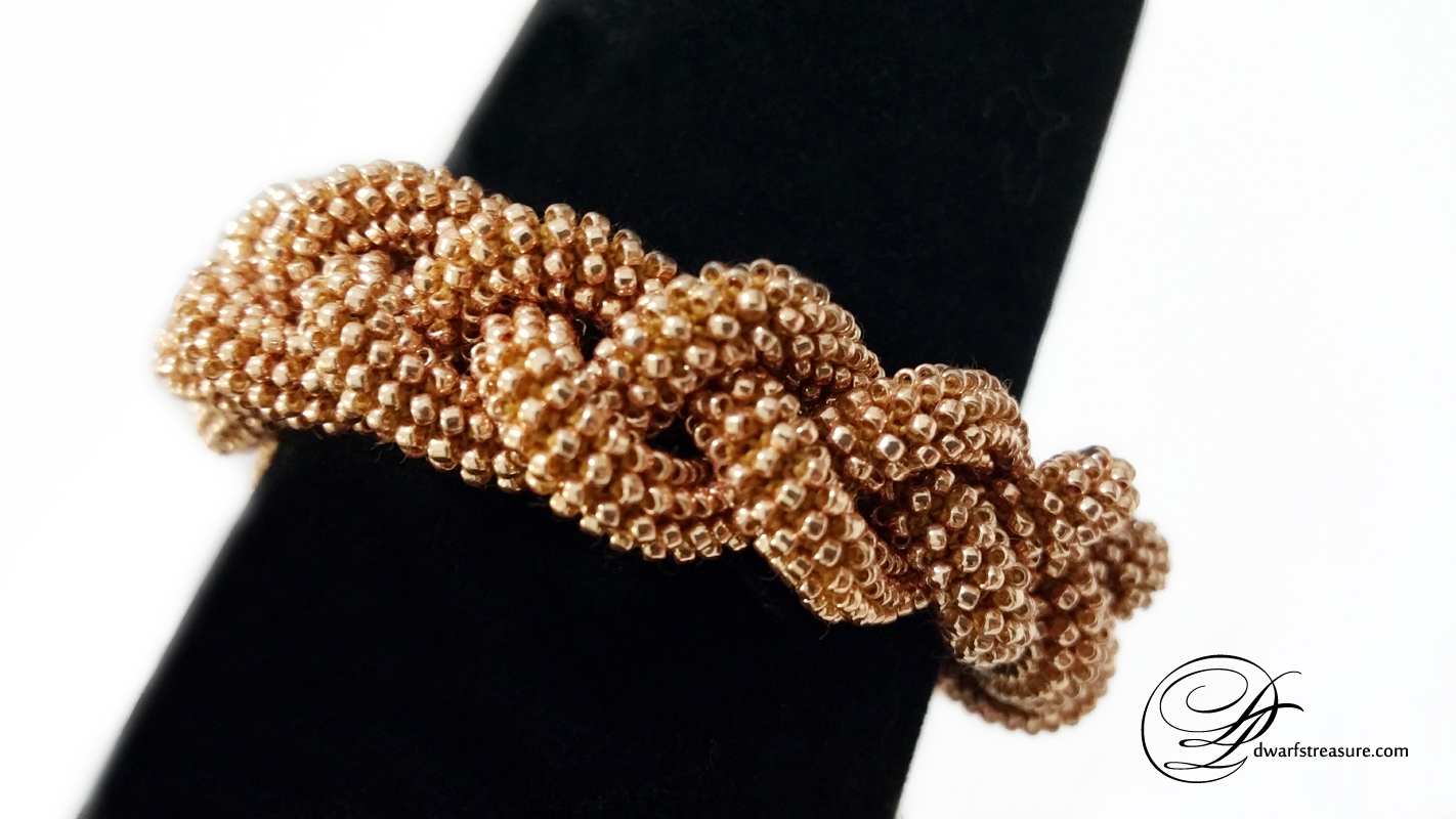 Fashionable pink gold beaded bangle bracelet