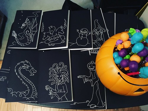 #halloween treat table ready with custom sketchbooks and skull-topped pencils