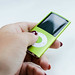 Woman's hand holding green ipod