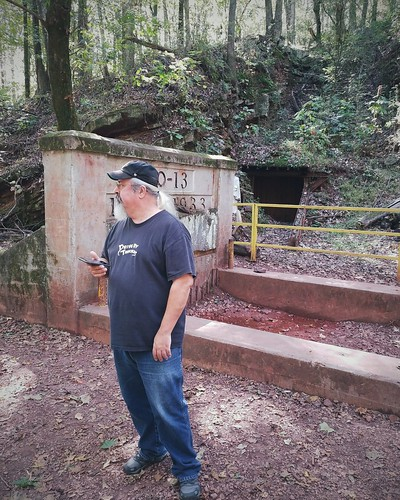 Jon standing outside of an abandoned iron mine. As one does.