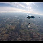 Skydivers Under Parachute