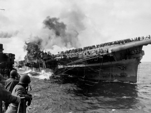 """""""USS Franklin"""" listing after a Japanese dive bomber attack Off Honshu, Japan March 19, 1945"""