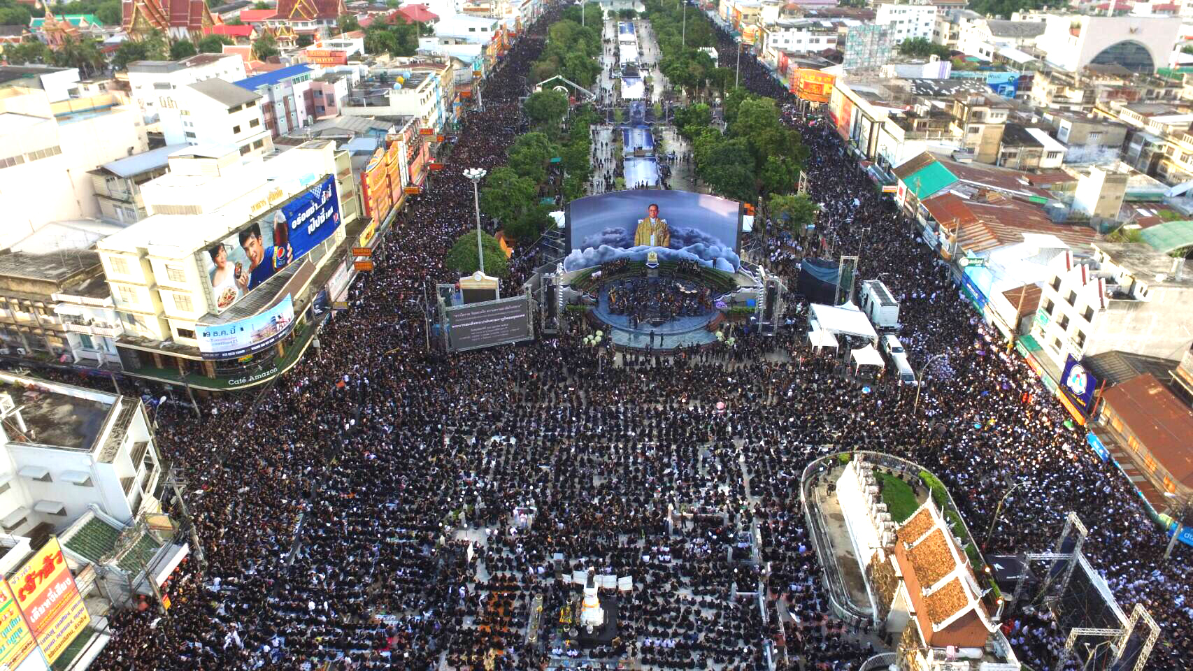Tens of thousands of people gather at the square in front of the Thao Suranari Monument in Nakhon Ratchasima to mourn the passing of His Majesty the late King Bhumibol Adulyadej, October 2016