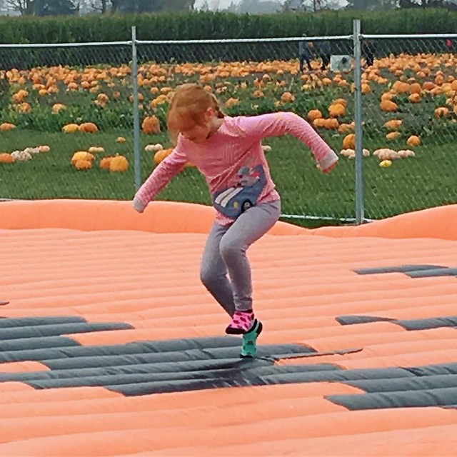 Ronia shows off some sweet moves on the bouncy pumpkin.