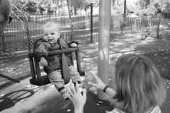 Ziggy swinging  with granny and mummy