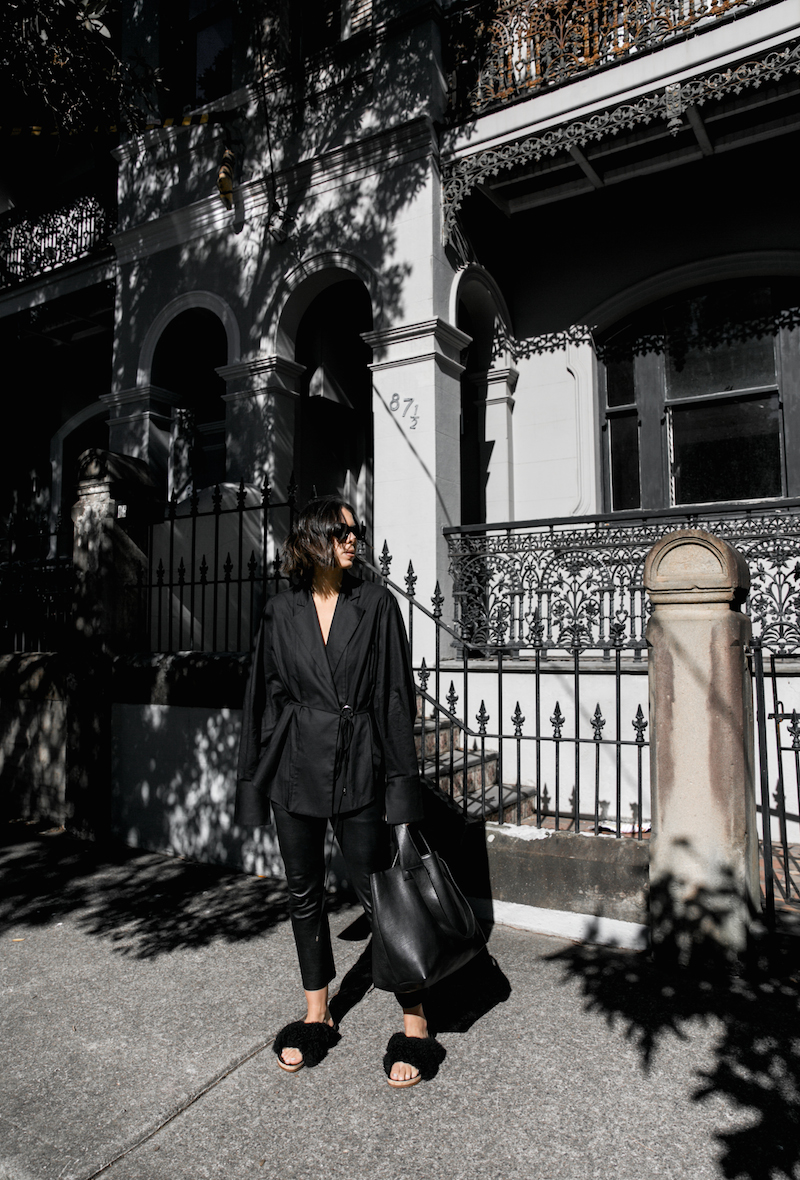all black outfit minimal street style oversized shirt leather pants shearling slides fashion blogger michael lo sordo shirt bassike chloe kaity modern legacy Instagram  (2 of 7)