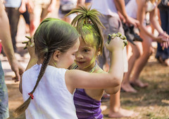 Little girls dance during the festival of color