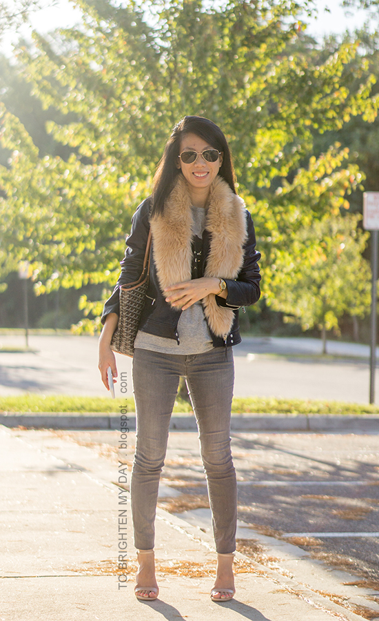 faux fur scarf, black leather jacket, gray graphic tee, gold watch, gray skinny jeans, nude heels