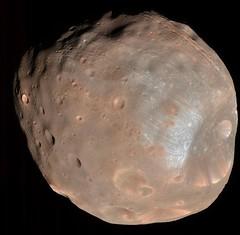 Solar Eruptions Could Electrify Martian Moons