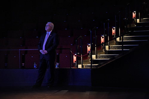 Chancellor Randy Woodson watches a video presentation during his annual fall speech in Stewart Theatre.