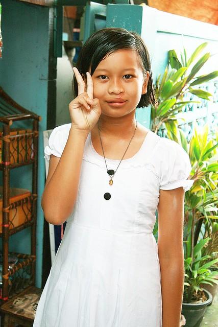 pretty girl sending you peace