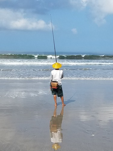 Fisherman on beach in Bali