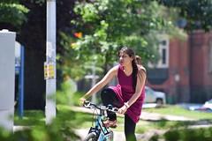 Mounting her bike...