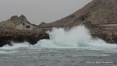 Heavy seas pound the rocks