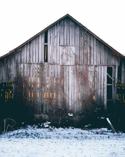Sunset through a barn in Potterville, MI. Photographer Dan Price