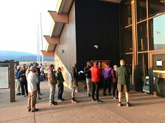 People line up and wait for visitor center to open