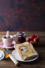 Fresh and bright continental breakfast table with jam on toast
