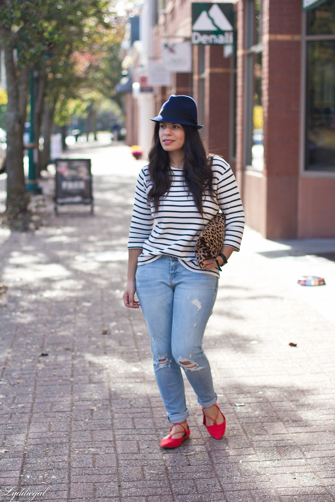striped shirt, distressed jeans, red flats, navy fedora, leopard clutch
