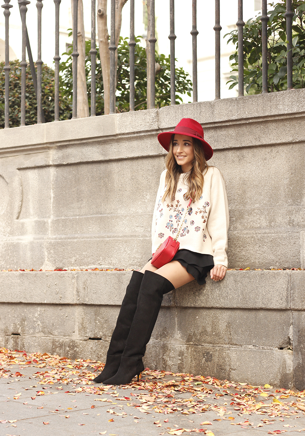 beige jersey with embroidered flowers over the knee black boots red hat street style fashion inspiration outfit08