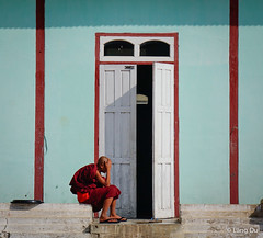 Novice boy at a wooden monastery in Myanmar