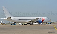 With full satisfaction photographed : Rolling Stones VIP Jet Aeronexus Boeing 767 (ZS-NEX) at Schiphol East