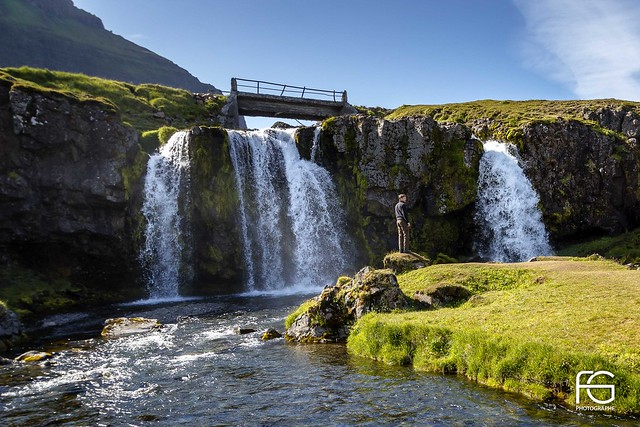 The man near the waterfall