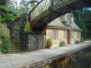 Footbridge to disused platform with surviving building at Cromford station
