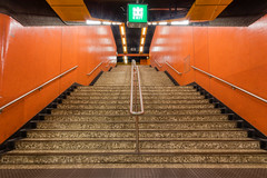 Hong Kong North Point metro staircase exit with red walls