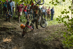 Unknown rider falls at overcoming the track in the woods