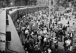 Japanese-Canadians wait at a train station for relocation to camps in the interior of British Columbia / Canadiens d'origine japonaise déplacés à des camps de la région intérieure de la Colombie-Britannique qui attendent un train