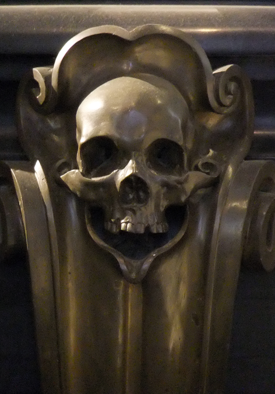 A skull decorates a pew in the New Church in Delft, Holland