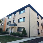 We picture whistling while walking home to this Edison Park apartment building each day. Don
