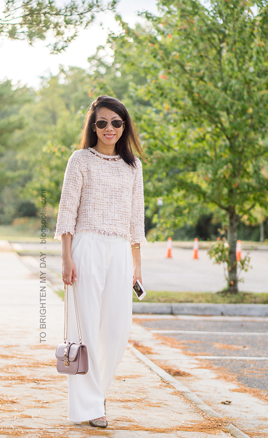 light pink tweed top with pearls, gold jewelry, white wide-legged pants, nude bag, glitter kitten pumps